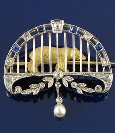 An Edwardian Belle Époque brooch depicting a caged bear- breathtaking.