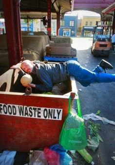 Freegan Tim Roberts salvages fruit and vegetables from a Queen Victoria Market skip.