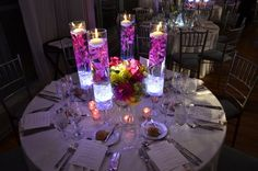 Lit orchid centerpiece. Not this tall, using blue for wedding color