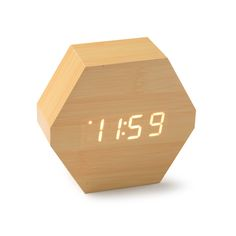 Reloj despertador con termómetro aspecto madera natural. La hora se ilumina con sonidos o con el tacto