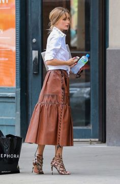 That skirt is leather...don't care what the shoes are I want them!  - B. A. S.