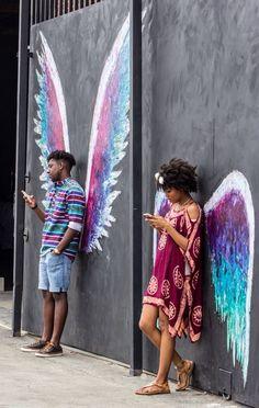 Recharge tes batteries en bonne humeur, la station est tenue par des anges gardiens ! / For good mood, Plug in ! / Street art. / By Elise Franck.