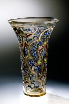 14thC, Syria. The Luck of the Eden Hall. The beaker may have been brought home by a crusader returning from the Holy Land back to Europe where such a rarity would have been considered the highest form of exotic luxury.
