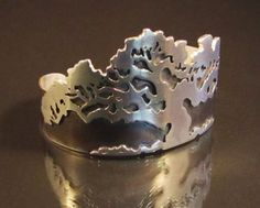 "Cuff | Jerry Wood.  ""Wind Blown Tree"".  Sterling silver, patina"