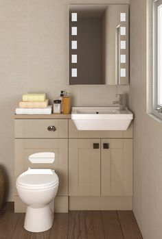 Starlet oyster gloss furniture combines the shaker style for Small fitted bathrooms