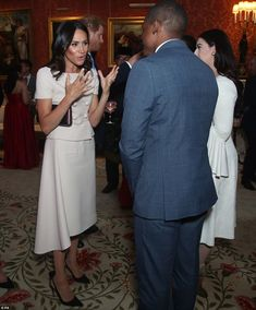 172ed2796ab2 In her element  A sharply-dressed Meghan was all smiles and looked in her