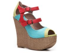 I have these!!  They're so tall I have trouble walking in them but they sure are cute.  2 Lips Too Too Detox Wedge Pump