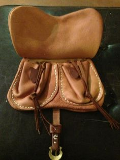 14th century leather pouch, inside flap showing two built in change purses.