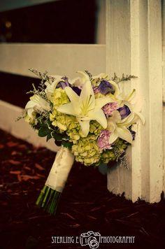 Bride's bouquet - green hydrangeas, white lilies, purple lisianthus, lavender carnations and caspia