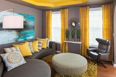 Yellow, grey, and blue for living room colours.