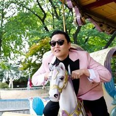 "Fashion-conscious Korean men are not afraid to wear pink, as Korean rapper Psy does in his infectious and deliciously silly ""Gangnam Style"" video.     http://www.youtube.com/watch?v=9bZkp7q19f0"