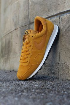 "Nike Air Pegasus 83 in ""Gold Suede""."