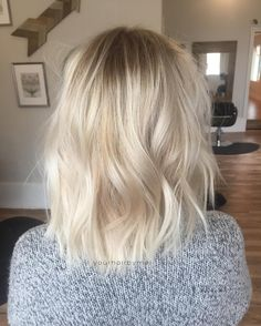 Bleached grow out softened with an 8n at root and a bit of balayage
