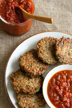 Red Lentil Cakes with Tomato Jam: These vegetarian lentil patties are crispy on the outside, soft on the inside, and generously spiced throughout. They're a great party starter, especially when paired with this homemade spicy tomato jam. Lentil Recipes, Veggie Recipes, Vegetarian Recipes, Cooking Recipes, Healthy Recipes, Healthy Dinners, Red Lentil Burger Recipe, Lentil Burgers, Veggie Burgers