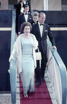 Queen Elizabeth II, Prince Philip, Princess Anne and Prince Charles disembark from HMY Bri...