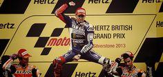 Jorge Lorenzo (Yamaha Factory Racing) celebrates winning at Silverstone over Marc Marquez and Dani Pedrosa