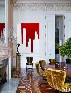 A resin painting by Piotr Uklański commands a corner of the room.