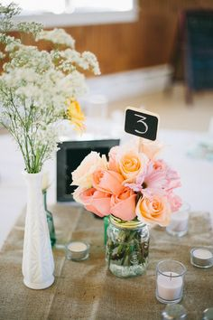 table numbers.... mini-chalk boards in flowers