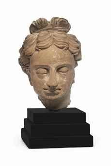 A Terracotta head of a youth Gandhara, circa 5th century 9 in. (22.8 cm.) high