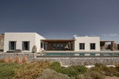 Villa Mandra in Mykonos by K-Studio.Photography by Claus Brechenmacher and Reiner Baumann. Living Divani, Patio Grande, Wooden Table And Chairs, Studio Build, Lounge Chair, Ground Floor Plan, Wooden Pergola, House Built, Scandinavian Design