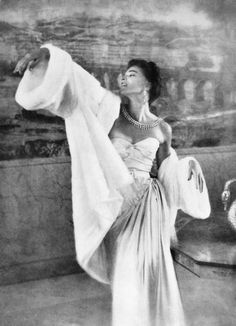 "Theo Graham wearing the ""Robe Gruau"" by Christian Dior Haute Couture at Helena Rubinstein's residence on the Ile Saint Luis in Paris. Harper's Bazaar Nov. 1949, photo by Richard Avedon."