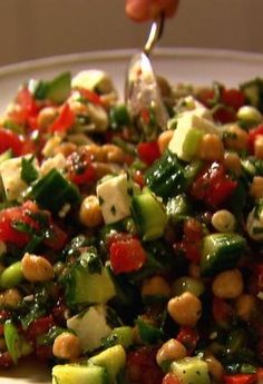 Middle Eastern Vegetable Salad recipe from Ina Garten via Food Network - REALLY yummy! Very similar to a Greek salad but with mint to give it something extra Vegetable Salad Recipes, Vegetarian Recipes, Cooking Recipes, Healthy Recipes, Cooking Ideas, Easy Recipes, Healthy Corn, Cooking Games, Wing Recipes