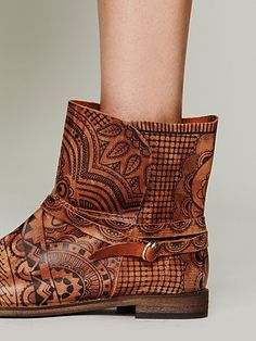 Leather henna patterned ankle boot with leather ankle strap and buckle detailing.