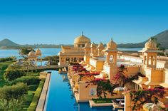 THE OBEROI UDAIVILAS, UDAIPUR—INDIA Set in Udaipur on the bank of Lake Pichola, this palatial resort affords every guest the chance to live like a king. The 50-acre property features a wildlife sanctuary, pristine gardens and only 87 total rooms and suites. Each of the outdoor pools has fantastic views, temperate water and a relaxing atmosphere.