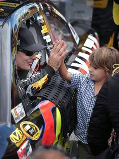 Leo gives Papa high-five after winning Brickyard 400