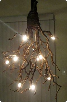 Confessions of Crafty Witches DIY branch chandelier. :) Easy to make from found wooden branches, hemp string to bind them and a string of outdoor globe lights. Perfect for a covered porch or a terrace/patio with an overhead trellis. Branch Chandelier, Rustic Chandelier, Chandelier Lighting, Driftwood Chandelier, Chandelier Crystals, Chandelier Ideas, Outdoor Chandelier, Table Lighting, Iron Chandeliers