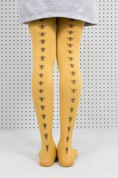 Save the bees and keep them on your legs! Our hand screen printed bees really stand out on the rich vibrancy of the 100 denier mustard tights. Wear them with anything! We like grey and mustard. Dark grey ink on mustard tights. Turn them inside out and machine wash delicate 30º 94% Nylon 6% Elastane As each pair is hand-printed they may vary slightly from the photo but they are all beautiful