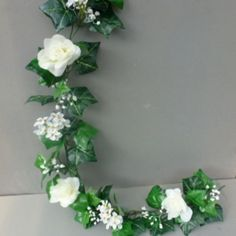 Garland with artificial ivory roses & blossom