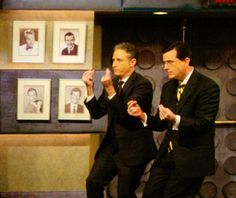 Jon Stewart and Stephen Colbert on Late Night with Conan O'Brien preparing to engage in battle.