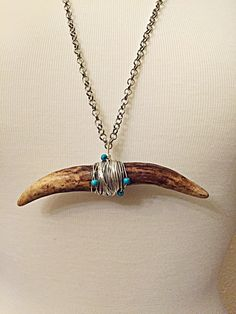 A personal favorite from my Etsy shop https://www.etsy.com/listing/229065162/handmade-natural-shed-antler-necklace