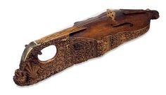 Housed in the British Museum is one of the most extraordinary medieval instruments. Dating from the early fourteenth century, this is the only surviving citole, a type of plucked instrument. Its edges are covered with intricate carvings depicting woodland scenes with real and imaginary creatures. This particular instrument was modified in the sixteenth century, and turned into a violin for Queen Elizabeth I. Thus the soundboard, fingerboard, and other fittings all postdate the Middle Ages.