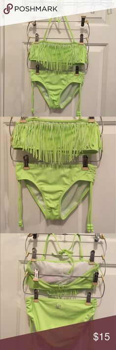 Size 12 Justice 2 Piece Swimsuit Size 12 Justice 2 piece swimsuit, fringe detailing on top, halter neck, ties on sides of the bottom to adjust the length of the sides, super cute bright lime/fluorescent color with silver! No rips, stains,piling or fading, excellent condition and gently used. Justice Swim