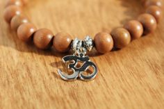 The wood bead bracelet makes a perfect addition to any arm stack and is a great gift for anyone who needs a little reminder of their place in the