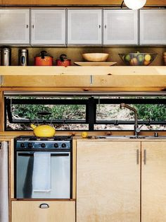 How to build a Tiny DIY Trailer on a Budget - Photo 3 of 12 - Container Store finds, like galvanized-steel shelving in the kitchen, maximize storage.