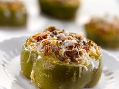 Italian Sausage Stuffed Bell Pepper Rings Recipe Main Dishes with Crisco Pure Vegetable Oil, green bell pepper, muffin mix, cornbread, buttermilk, large eggs, sweet italian sausage, onions, jalapeno chilies, green chilies, diced tomatoes, shredded colby, shredded mozzarella cheese