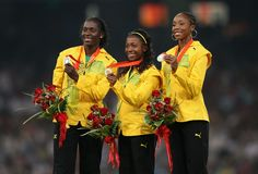 1,2,2! (L-R) Joint silver medalist Sherone Simpson, gold medalist Shelly-Ann Fraser and joint silver medalist Kerron Stewart of Jamaica at Beijing 2008 Olympics