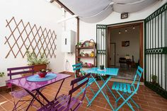 Mad in Ballarò B&B and Design, your accomodation in the heart of Palermo, Sicily. The colorful terrace. #palermo #sicily #bedandbreakfast #breakfastincluded #livingroom #travel #accomodation #italy