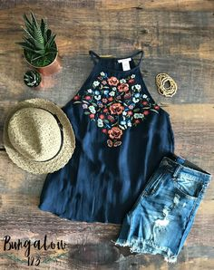 Gorgeous Spring and Summer top in navy featuring multi-floral embroidery along the top. Pullover style with single button at nape of neck. Shown with the Lumen Fedora and B123 Distressed Boyfriend Sho