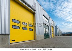 industrial warehouse with green and yellow roller doors by hans engbers, via Shutterstock