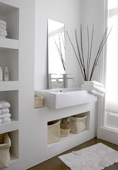 Built in shelves in the bathroom, love the look of these thick shelves