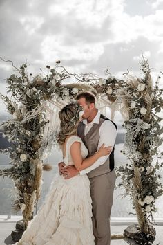 Epic first kiss moment all the way in Greece | Image by Lily Red Creative #destinationelopement #greece #santorini #elopement #elopementininspiration #destinationwedding #bride #bridalinspiration #bridalstyle #groom #groomstyle #groominspiration #coupleportrait #weddingportrait #floraldesign #weddingfloraldesign #ceremony #weddingceremony