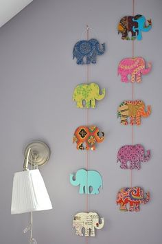 Scrapbook paper cutouts hung with twine
