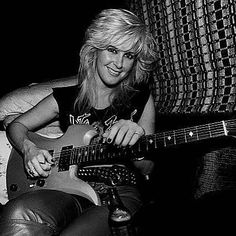 Portrait of American Rock musician Lita Ford as she poses with a guitar in her tour bus, Chicago, Illinois, September Get premium, high resolution news photos at Getty Images Ladies Of Metal, Rock And Roll Fantasy, Lita Ford, Women Of Rock, Rocker Girl, Joan Jett, Stock Pictures, Get The Look, Rock N Roll