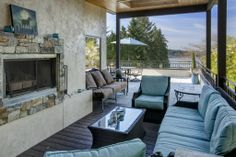 The cool blue patio furniture matches the beautiful clear sky. Mercer Island, WA Coldwell Banker BAIN $2,600,000 #patio