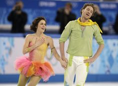 Nathalie Pechalat and Fabian Bourzat of France react after completing their routine in the ice dance free dance figure skating finals at the...
