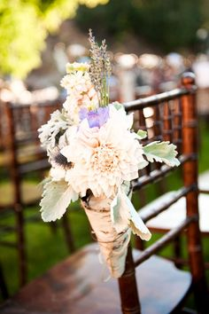 Birch Flower cone for ceremony Chairs-Something similar to this for the pews. Maybe a different look to the cones. But love the simplicity of this idea! <3